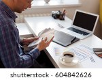 a designer surfing the color... | Shutterstock . vector #604842626