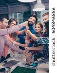 happy businesspeople putting... | Shutterstock . vector #604846886
