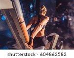 sportive woman using machine... | Shutterstock . vector #604862582