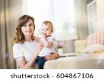 mom with a baby eleven months... | Shutterstock . vector #604867106