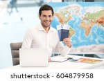 young man tour agency concept | Shutterstock . vector #604879958