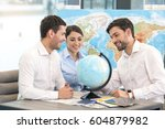 Small photo of Young Man Travel Agent with Clients Concept