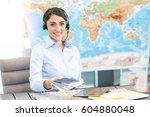 young woman travel agent concept   Shutterstock . vector #604880048