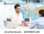 Small photo of Man and Woman Travel Agency Concept