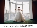 bride near the window  | Shutterstock . vector #604899176