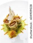 paccheri pasta stuffed with...   Shutterstock . vector #604909028