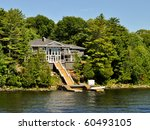 Summer home on water - stock photo