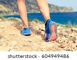 hiking or running woman in... | Shutterstock . vector #604949486