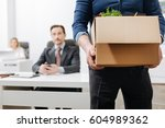 confident employee leaving the... | Shutterstock . vector #604989362