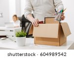 upset office manager packing... | Shutterstock . vector #604989542