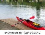 a red canoe harboring at the... | Shutterstock . vector #604996142