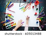 hands of a kid drawing with... | Shutterstock . vector #605013488