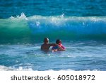 surf lessons. costa rica ... | Shutterstock . vector #605018972