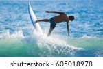 riding the waves. costa rica ... | Shutterstock . vector #605018978
