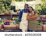 greengrocer selling organic... | Shutterstock . vector #605028308