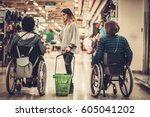 young girl helping two disabled ... | Shutterstock . vector #605041202