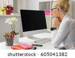 woman working on computer | Shutterstock . vector #605041382