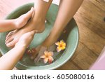 masseur washing woman's foot or ... | Shutterstock . vector #605080016