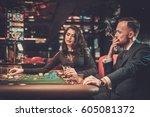 upper class friends gambling in ... | Shutterstock . vector #605081372