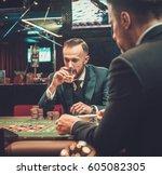 Upper Class Friends Gambling In ...