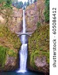 Small photo of Beautiful 2 tiered Multnomah Falls 30 minutes east of Portland, Oregon along Columbia River Gorge. Tallest waterfall in the state at 611 feet, 542 upper & 69 lower, with a foot bridge for visitors.