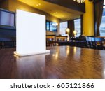 mock up menu frame on table... | Shutterstock . vector #605121866