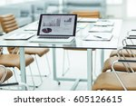 workplace with open laptop and ... | Shutterstock . vector #605126615