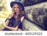 beautiful woman wearing boho... | Shutterstock . vector #605129222