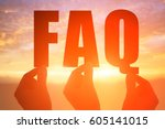silhouette of hand take faq... | Shutterstock . vector #605141015