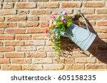 flower pot hanging on the brick ...   Shutterstock . vector #605158235