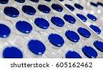 rows of medication vials | Shutterstock . vector #605162462