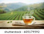 tea cup with and tea leaf... | Shutterstock . vector #605179592