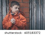 portrait of sad little boy... | Shutterstock . vector #605183372