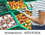 young woman shopping healthy...   Shutterstock . vector #605191826