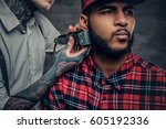 close up portrait of tattooed... | Shutterstock . vector #605192336