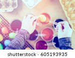 painting easter eggs with... | Shutterstock . vector #605193935