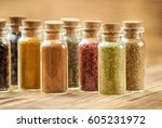 spices in jars on wooden... | Shutterstock . vector #605231972