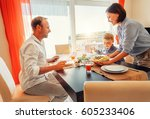 mother brings a dish of meal at ... | Shutterstock . vector #605233406