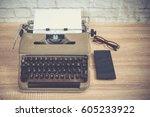 vintage typewriter  smartphone  ... | Shutterstock . vector #605233922