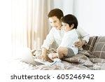 cute little boy and her... | Shutterstock . vector #605246942
