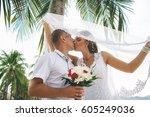 beach wedding ceremony   Shutterstock . vector #605249036