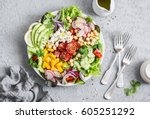 spring vegetable salad with... | Shutterstock . vector #605251292