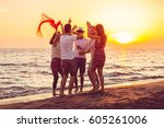young people dancing on beach... | Shutterstock . vector #605261006