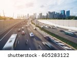busy road and city background... | Shutterstock . vector #605283122