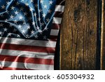 usa flag on a wood surface | Shutterstock . vector #605304932