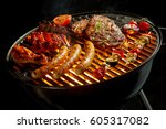 assorted meat grilling over the ... | Shutterstock . vector #605317082