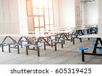 Stock photo clean school cafeteria with many empty seats and tables 605319425