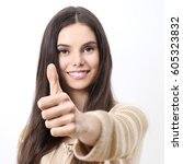 Small photo of Happy smiling woman with thumbs up, gesturing like, isolated in white background