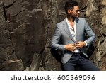 man in elegant suite posing in... | Shutterstock . vector #605369096