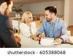 young business couple signing a ... | Shutterstock . vector #605388068